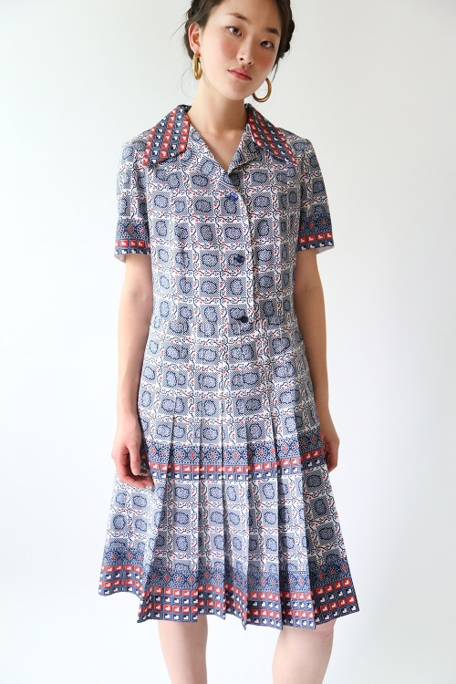 NAVY PRINTED PLEATS DRESS